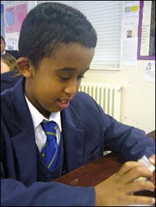 Yusuf looks at sulphur in science class