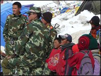 Chinese soldiers with captured Tibetan children