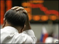 Stock Market trader holds his head at the Manila Stock Exchange