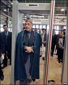 Hamid Karzai walked through a metal detector at the airport opening