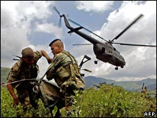A helicopter drops Colombian soldiers during an operation against rebel cocaine factories in August 2005