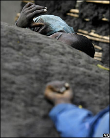 The bodies of two people allegedly shot by rebel soldiers loyal to Gen Laurent Nkunda in Kiwanja (6 November 2008)