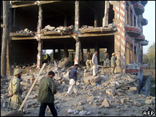 Pakistani security officials inspect the site of a suicide attack in Mingora, the main town in the restive Swat valley