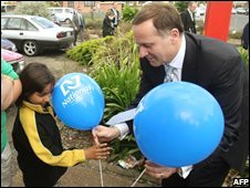 Nez Zealand prime ministerial candidate John Key campaigns in Auckland on Friday