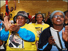 """Supporters attend a meeting by former South African Defence Minister Mosiuoa Lekota, wearing T-shirts saying """"South African National Congress"""""""
