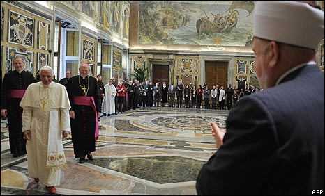 Pope Benedict walks towards the Muslim Mufti of Bosnia, Mustafa Ceric (right), at the Clementine Hall in the Vatican on 6/11/08