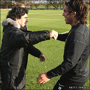 Maradona make a bee-line for Argentina star Carlos Tevez ahead of the side's friendly in Scotland on 19 November