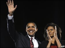 Barack Obama waves beside wife Michelle during his election night victory rally at Grant Park in Chicago, Illinois