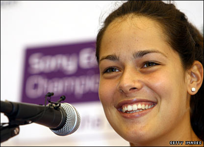Ana Ivanovic puts a brave face on having to withdraw ahead of her final round-robin match because of a virus
