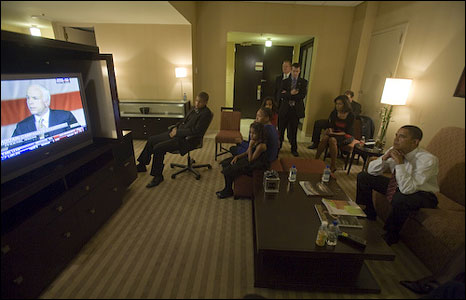 Barack Obama watches John McCain on TV
