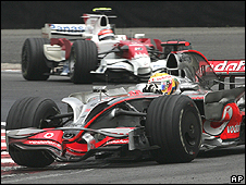 Lewis Hamilton passes Timo Glock in the crucial last race at Interlagos
