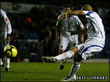 Andy Robinson scores Leeds' equaliser from the penalty spot