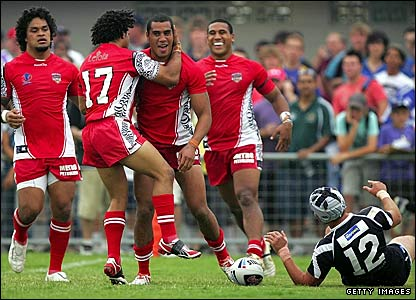 Fetuili Talanoa (centre) is congratulated after scoring a try for Tonga