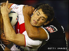 Paul Wellens is wrapped up by the Kiwis defence