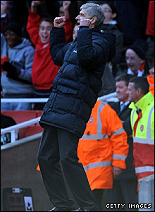 Arsenal manager Arsene Wenger celebrates the 2-1 win over Manchester United