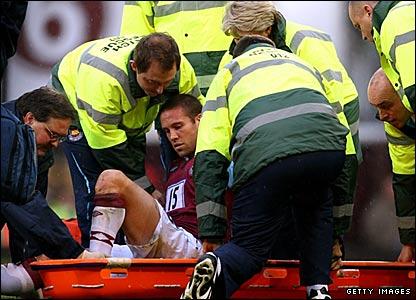 West Ham's Matthew Upson is stretchered off