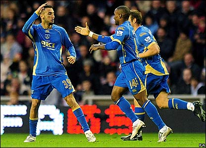 Nadir Belhadj (left) is congratulated after scoring Portsmouth's equaliser at Sunderland