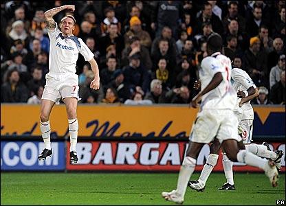 Bolton's Matt Taylor (left) celebrates his goal