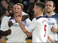 Matthew Taylor (second left) celebrates scoring for Bolton