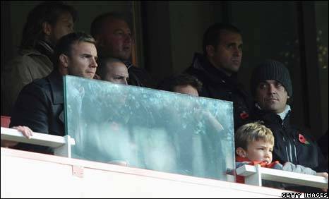 Gary Barlow (left) and Robbie Williams (right) watch Arsenal play Manchester United