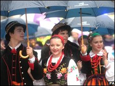 Members of London's Polish community take part in the Lord Mayor's Show under umbrellas