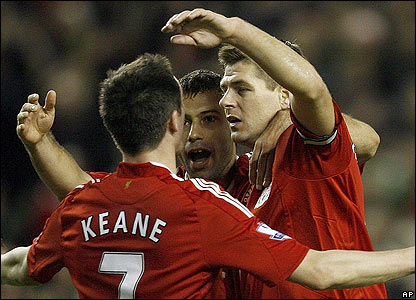 Keane is mobbed by his team-mates after scoring his second for Liverpool