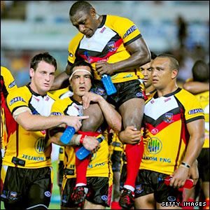 Stanley Gene is carried off the field on the shoulders of his team-mates after calling time on his PNG career