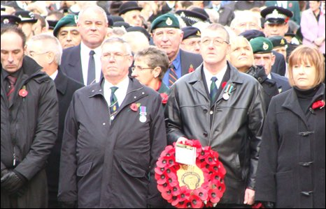 People wait to lay poppy wreaths