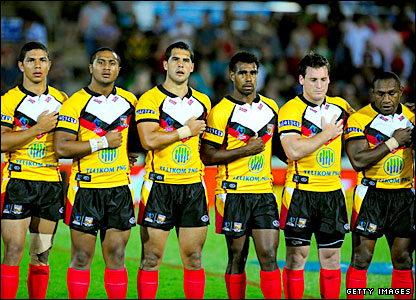 Papua New Guinea's players line up for the national anthems