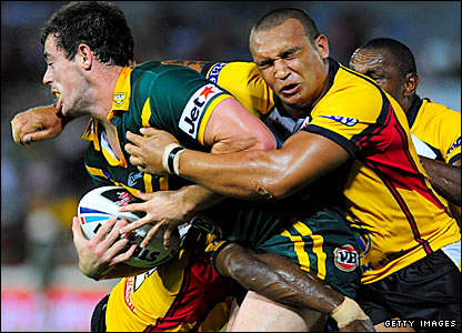PNG enforcer Neville Costigan puts in a tackle on Terry Campese