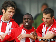 Brentford celebrate the opening goal by Marvin Williams (centre)