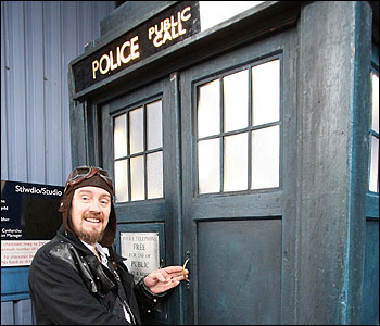 A suitably-dressed Dan Norris from Leicester gets to open the doors to the Tardis so the tour can begin