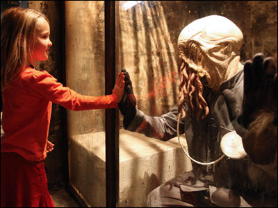 A young visitor gets close - but not too close - to an Ood