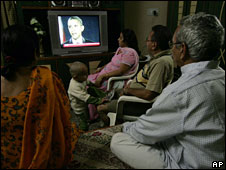 A family India watches Barack Obama's win on TV