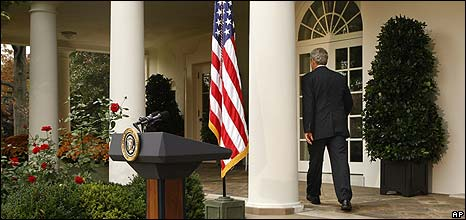 President George W Bush leaves the Rose Garden after speaking to staff, 6 November 2008