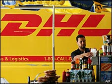 DHL delivery truck is parked next to a hot dog stand in New York