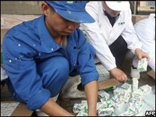 Chinese workers destroy boxes of contaminated milk, Wuhan, 5 Nov