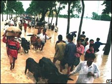 Whole villages seek refuge on higher land from Bangladesh's floods