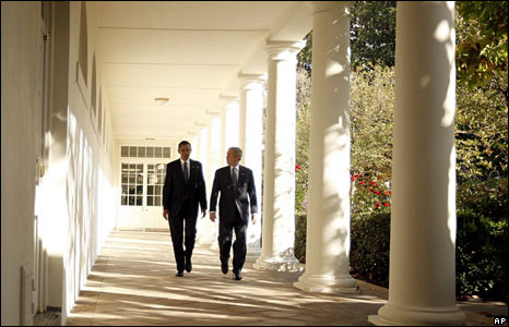Mr Obama and Mr Bush walk along the Colonnade to the Oval Office