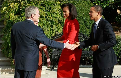 Mr Bush and Mr Obama shake hands outside the White House