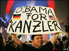 A German Obama supporter holds up a sign saying (in German) Obama for Chancellor, 4 November 2008