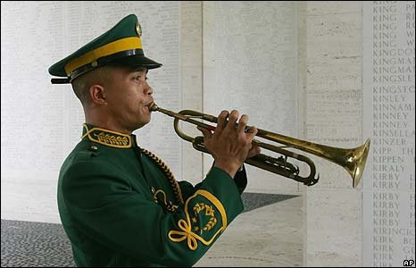 Filipino soldier plays the trumpet at the American cemetery, Manila