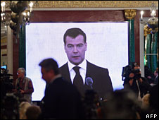 Russian President Dmitry Medvedev is seen on a giant screen as he delivers a speech at the Kremlin
