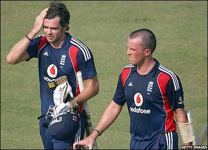 James Anderson and Graeme Swann walk off after defeat