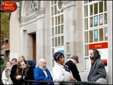 People queuing outside Post Office in London