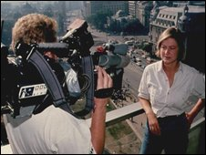 Kate Adie being filmed by a cameraman