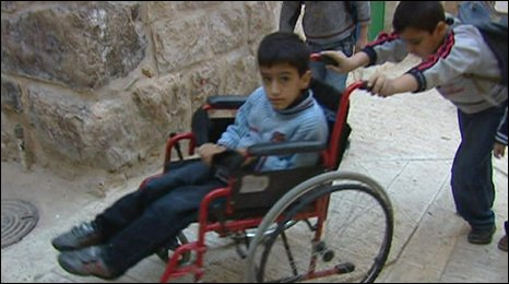 Mohammed Taha is pushed to school by his brother Amjad
