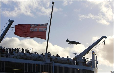 An RAF Harrier jet dips its nose in tribute to QE2