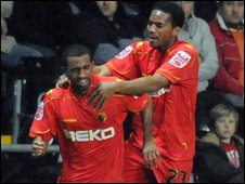 Watford's Lee Williamson is congratulated by Adrian Mariappa after scoring