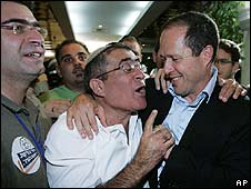 Nir Barkat (R) is congratulated by a supporter following partial results